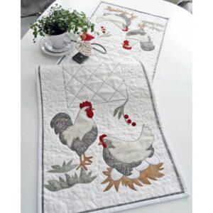 Stolt tupp med høne